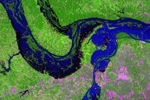 This is a NASA enhanced satellite image of the extent of floodwaters in the summer of 1993 at the confluence of Missouri, Mississippi and Illinois Rivers.